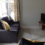 Curl up and relax in Apartment Three after a day exploring Coniston and around