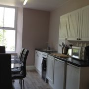 The kitchen and dining area in Apartment Two